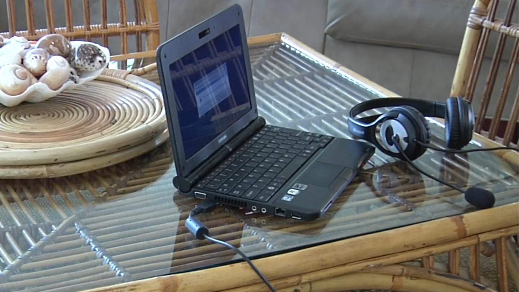 Computer & headphones sitting on desk